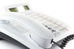 Desktop phone. White modern enterprise desktop phone Stock Photo
