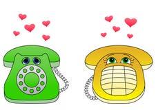 Desktop phones-enamoured Royalty Free Stock Image