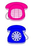 Desktop phones, pink and blue Royalty Free Stock Image