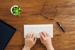 Desktop scene on wooden table Stock Images