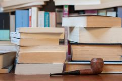 Books and pipe Stock Images