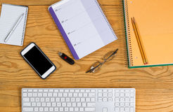 Desktop with stationery and tools for daily planning Royalty Free Stock Images