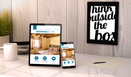 Desktop tablet and phone booking hotel reservation Royalty Free Stock Photography