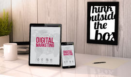 Desktop tablet and phone digital marketing. Digital generated tablet and phone on a desktop workplace digital marketing on screen. All graphics are made up Stock Photography