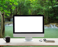 Desktop white frame on work table and waterfall nature. Desktop computer white frame on work table and waterfall nature background Royalty Free Stock Photo