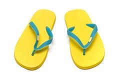 Deslizadores das sandálias no fundo branco Fotos de Stock