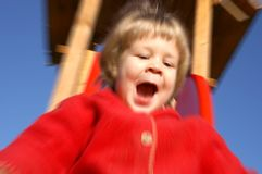 Deslizando a menina na ação Fotos de Stock