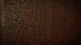 Deslizar el vídeo de una superficie barnizada de madera metrajes