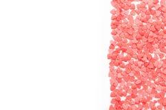 Desmoches rojos de Funfetti de los corazones en el fondo blanco Foto de archivo libre de regalías