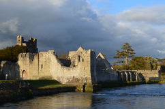 Desmond Castle Ruins with Reflections in the River Maigue Stock Photo