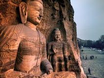 Desned Buddha Yungang grottor, Datong, Shanxi, Kina Arkivfoton