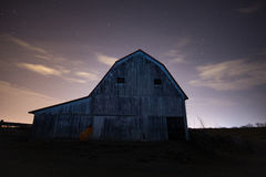 Desolate Barn after Dark. An abandoned hay barn on a farm after dark royalty free stock photo