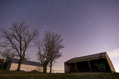 Desolate Barn after Dark. An abandoned hay barn on a farm after dark stock image