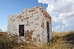 Desolate building. A desolate building in the fields with cloudy sky Royalty Free Stock Image