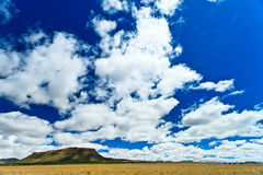 Desolate landscape with beautiful cloudscape Royalty Free Stock Image