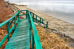 Desolate old walkway to beach in the springtime Stock Images