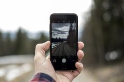 Desolate road seen through an iphone royalty free stock images