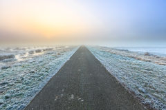 Desolate road in a winter rural landscape Royalty Free Stock Photography