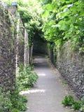 Desolate rock wall path Stock Photo