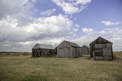 Desolate storage sheds. Abandoned wooden shacks once used as coastal garages and to store small fishing boats Stock Image