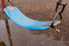Desolate swing in early spring Royalty Free Stock Images