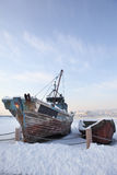 Desolated boat. On a lake in winter Stock Photography