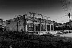 Desolated Building. This dramatic black and white photography shows a desolated old building in Cinarcik town of the country Turkey. Cinarcik is a district of stock photography