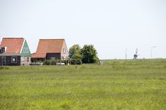 Desolated houses in the rural surrounding of the island Marken. Netherlands,North Holland,Marken, june2016: meadows and rural land in the island of Marken Stock Images