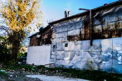 Desolated Old Building With Metal Plates Stock Photo