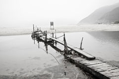 Desolated pier next to the sea Royalty Free Stock Photography