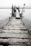 Desolated wooden pier in low saturation Stock Photo