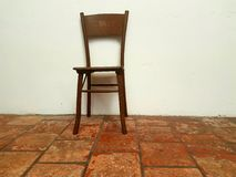 The desolateness. The old chair in old house on old floor Royalty Free Stock Photos