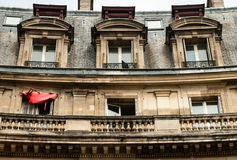 Desolatied building, Paris. Desolated building with torn red sunshade in Paris Stock Photo