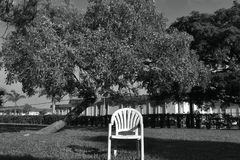 Desolation. The chair show us and give us some feeling of desolation when we look deeply inside the photo royalty free stock photo
