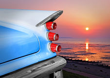Desoto dreams. Photo of an american classic vintage desoto car with tropical sunset over the coast Stock Photography