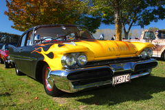 Desoto hotrod classic car with flame custom paint job. Custom hotrod rebuild of Desoto classic car with yellow flame paint over black Royalty Free Stock Photo