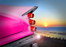Desoto sunset. Photo of an american classic vintage desoto car cruising along the coast at sunset Royalty Free Stock Images