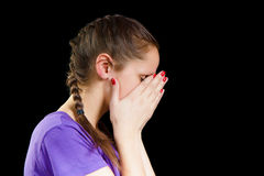 Despair. Young woman covered her face with her hands Royalty Free Stock Images