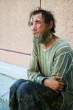 Despair. Despair of the poor homeless beggar royalty free stock photo