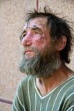 Sad homeless man stock photo