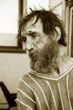 Despair. Despair of the poor homeless beggar stock images