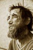 Despair. Despair of the poor homeless beggar royalty free stock image