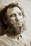 Despair. Despair of the poor homeless beggar stock image