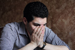 Despair of arab egyptian businessman. Image of arabian egyptian business man wearing shirt and feeling sad and depressed Royalty Free Stock Photography
