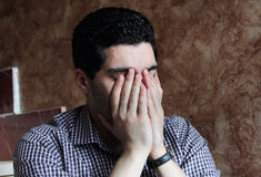 Despair of arab egyptian businessman. Image of arabian egyptian business man wearing shirt and feeling sad and depressed Royalty Free Stock Photos