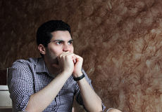 Despair of arab egyptian businessman. Image of arabian egyptian business man wearing shirt and feeling sad and depressed looking at future Stock Photo
