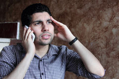 Despair of arab egyptian businessman talking with phone Royalty Free Stock Photos