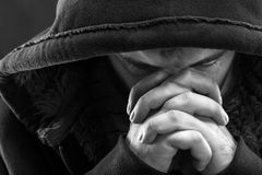 Praying bandit. Despair bandit praying God for forgiveness royalty free stock images