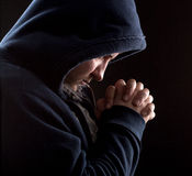 Praying bandit Royalty Free Stock Photos