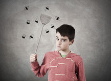 Despair. Child with expression shooing flies Stock Image